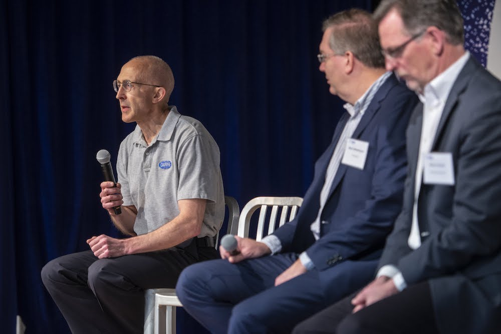 Left to right: DARPA's Peter Highnam discusses STEM workforce needs with Perspecta's Mark Westergren and Riverside Research Steve Omick. Photo: WashingtonExec