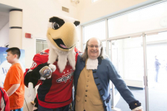 Slapshot, the official mascot for the Washington Capitals, and America's Inventor Ben Franklin pose for a photo.