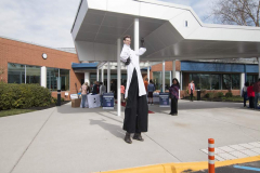 A man on stilts welcomed STEM Symposium guests.
