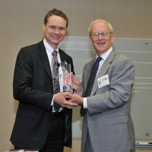 "Northrop Grumman Chairman, CEO and President Wes Bush (left) accepts an award for ""Commercial Business Partnership in support of the AbilityOne Program"" from Bob Chamberlin, CEO and President of SourceAmerica."