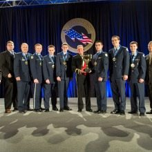 "The winning team and coaches of the National Champion title for the All Service Division at the CyberPatriot VI Finals Competition in March, 2014. The team, the ""Fearsome Falcons,"" hails from Clearfield High School in Utah."