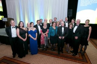 The Community Foundation for Northern Virginia awarded the 2014 Community Leadership Award to Richard Duvall (second from right), and Holland & Knight LLP for their philanthropic leadership and dedication to community service in the region at the Sweet Home Virginia Gala. Stuart Mendelsohn (forth from right) served as the Gala co-chair. They are joined by family and other members of the Holland & Knight law firm.