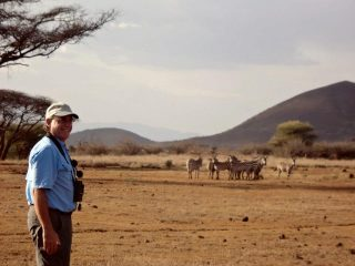 Stan Soloway on the ranch, wandering to the zebras