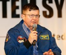 Kenneth Cameron addresses the 2015 K-12 STEM Symposium on his experience as a NASA astronaut