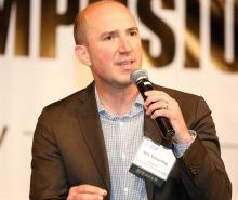 Vencore's Eric Schierling, who served as an F18 Top Gun pilot, speaks at the 2015 K-12 STEM Symposium
