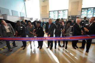 Frank Kendall, center, undersecretary of defense for acquisition, technology and logistics, helps to cut the ceremonial ribbon symbolizing the opening of a FLEX-ACE Lab at Francis L. Cardozo Education Campus. Photo credit: Marvin Lynchard