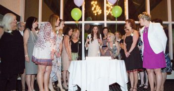 """Bite Me Cancer founder Nikki Ferraro (center) is surrounded by fellow  cancer survivors during the cake cutting at the third annual """"Cancerversary""""  Dinner, held April 23, 2016, at the Tower Club in Tysons Corner, Va. Photo courtesy Bite Me Cancer."""