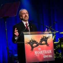 Attain LLC Chairman and CEO Greg J. Baroni receives the Outstanding Achievement Award at the 2016 National Kidney Foundation's Masquerade Ball