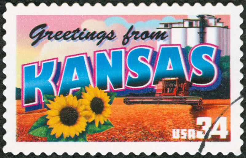 Postage Stamp saying Greetings from Kansas