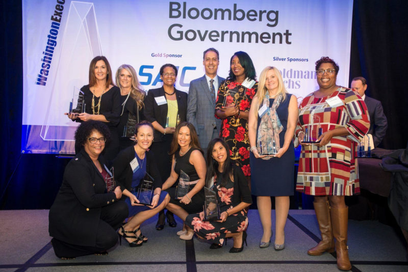 Top row, third to the right: Patrice Johnson of ASRC Federal, with her fellow EA of the Year winners and JD Kathuria