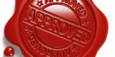 Brown wax seal with Approved written