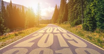 Empty asphalt road and New year 2018, 2019, 2020 concept. Driving on an empty road in the mountains to upcoming 2018, 2019, 2020 and leaving behind old years. Concept for success and passing time.