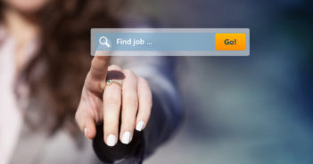Woman looking for job by pressing search button on virtual touch screen.