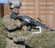 Army Sgt. Michael Zamora uses a prototype Third Army exoskeleton to easily aim an 18-pound M249 light machine gun during testing at Aberdeen Proving Ground, Maryland, March 18. 2017. U.S. Army photo: Conrad Johnson
