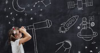 Schoolgirl standing in front of a blackboard, watching stars through a chalk-drawn telescope, learning about space and astronomy