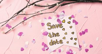"Composition with ""Save the date"" card on color background"
