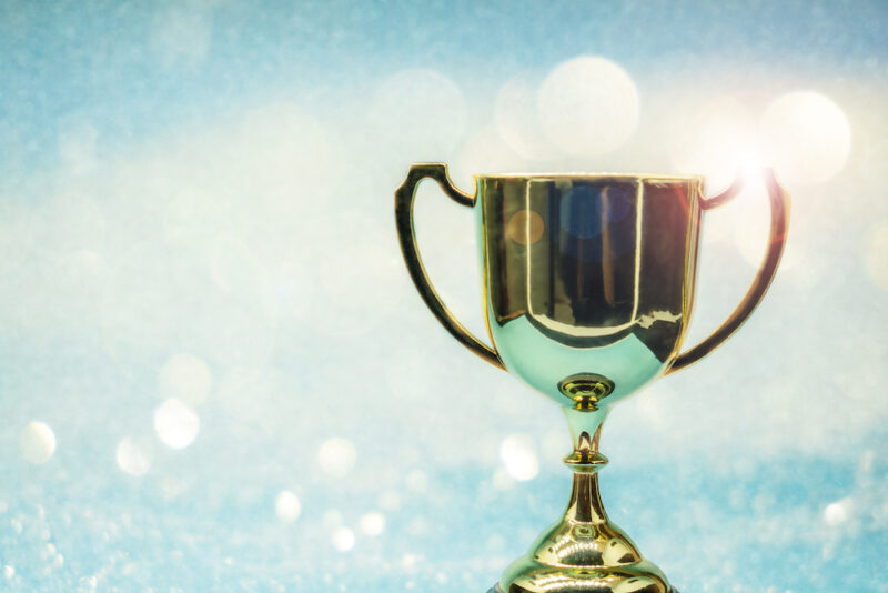 trophy over wooden table and background bokeh.