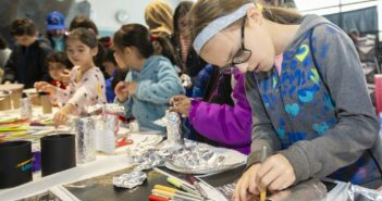 Students explored the many hands-on demonstrations at Riverside Research's mini Open Innovation Center.