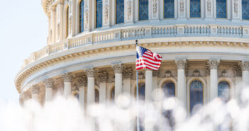 US Congress dome closeup with background of water fountain splashing, American flag waving in Washington DC, USA closeup on Capital capitol hill, columns, pillars, nobody