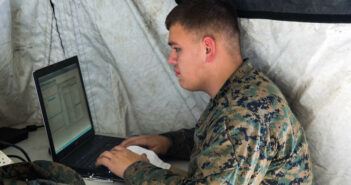 Pfc. Alec Rivera, a cyber-network specialist with Headquarters Company, Combat Logistics Regiment 25, works on a computer during a command post exercise at Camp Lejeune, N.C., Feb. 2, 2016. As a cyber-network specialist, Rivera is responsible for configuring and maintaining connectivity across networks. (U.S. Marine Corps photo by Cpl. Paul S. Martinez/Released)