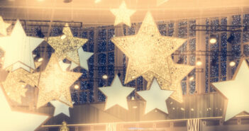 Stars shape show celebrity background with spotlights soffits in vintage yellow golden colors as stage performance background