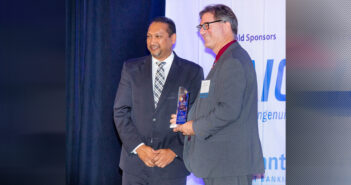 Joshua Gustin is one part of the Federal Aviation Administration group that received WashingtonExec's Pinnacle Award Government TEAM Project of the Year from SAIC's Sanjay Sardar on Oct. 31.