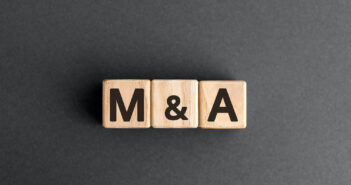 M&A- acronym from wooden blocks with letters, mergers and acquisitions M&A concept, top view on grey background (M&A - acronym from wooden blocks with letters, mergers and acquisitions M&A concept, top view on grey background, ASCII, 114 components