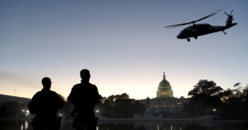 Soldiers guard Capitol Hill as a helicopter patrols the air. Image: ninjaMonkeyStudio/iStock