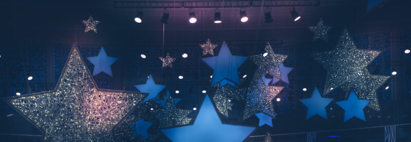 Vintage night shining stars shape spotlights soffits show stage performance background with gradient dark blue pink lilac purple lights