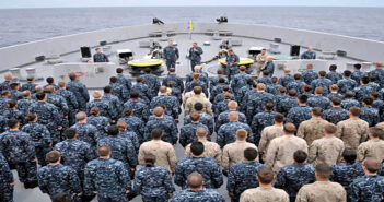 110818-N-GW695-584 INDIAN OCEAN (Aug. 18, 2011) Cmdr. Kevin Meyers, commanding officer of the amphibious transport dock ship USS Green Bay (LPD 20), addresses Sailors and Marines during an all-hands call on the focÕsle of the ship. Green Bay and the embarked 13th Marine Expeditionary Unit (13th MEU) are underway in the U.S. 7th Fleet area of responsibility during Green BayÕs first western Pacific deployment. (U.S. Navy photo by Mass Communication Specialist 3rd Class Stephen M. Votaw/Released)