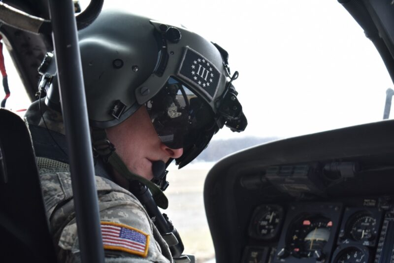 A N.Y. Army National Guard pilot assigned to 3rd Battalion, 142nd Aviation, prepares for a flight in a UH-60 Black Hawk Helicopter at Army Aviation Support Facility # 3 in Latham, N.Y., on April 5, 2018. The 3-142nd was flying Siena College students with the Reserve Officer Training Corps to Burlington, V.T. for their monthly training. (N.Y. Army National Guard photo by Spc. Andrew Valenza)