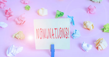 Writing note showing Nominations. Business concept for action of nominating or state being nominated for prize Colored crumpled papers empty reminder pink floor background clothespin (Writing note showing Nominations. Business concept for action of no