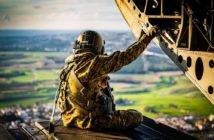"""Staff Sgt. Daniel Pennington, a flight engineer assigned to B Co """"Big Windy,"""" 1-214th General Support Aviation Battalion, takes in his 'office' view from the ramp of his CH-47 Chinook while flying over the island of Cyprus on Jan. 14, 2020. (U.S. Army photo by Maj. Robert Fellingham)"""