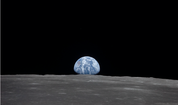 This view from the Apollo 11 spacecraft shows the Earth rising above the Moon's horizon in July 1969. The lunar terrain pictured is in the area of Smyth's Sea on the nearside. Image: NASA