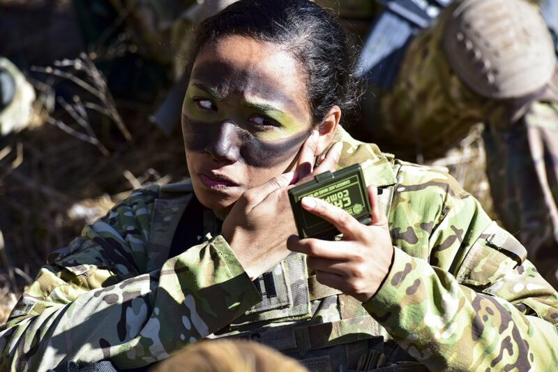 .S. Army Capt. Julissa Myers, Paratrooper assigned to the 173rd Brigade Support Battalion, 173rd Airborne Brigade, puts the finishing touches to her face paint camouflage in preparation a blank-fire exercise as part of Lipizzaner V at Pocek Range in Postonja, Slovenia, March 12, 2019. Lipizzaner is a combined squad-level training exercise in preparation for platoon evaluation, and to validate battalion-level deployment procedures. (U.S. Army photo by Paolo Bovo)