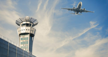 Air Trafic Control tower and airplance at Orly, Paris Airport