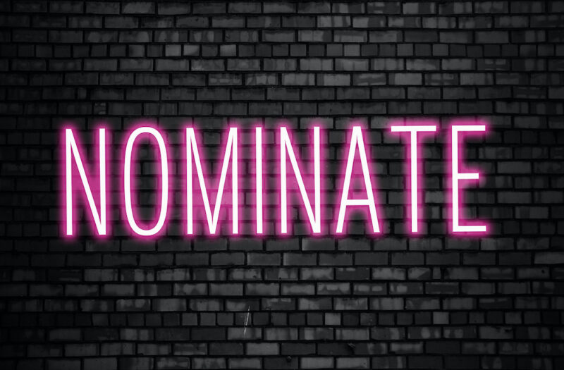 Nominate glowing pink neon sign on black brick wall. Business winner achievement concept for Election Nomination. (Nominate glowing pink neon sign on black brick wall. Business winner achievement concept for Election Nomination., ASCII, 114 components
