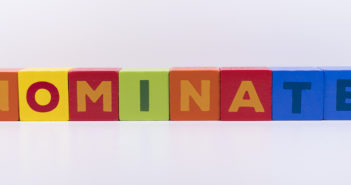 NOMINATE word made with building colored blocks