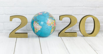 2020 new year and globe on white wood table over white background with copy space , save earth concept