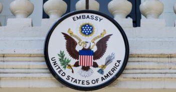 An American flag and U.S. embassy seal hang outside the American embassy in Chisinau, Moldova