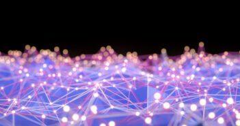 Network mesh, chaos, blockchain. Defocused lights. Image: akinbostanci/iStock