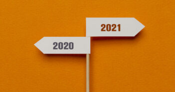 Two directional sign on the orange background. Image: solidcolours/iStock