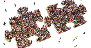 Large group of people in the shape of two puzzle pieces on a white background.